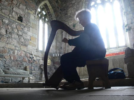 Orchestra member Margaret Love plays in the Abbey at Iona, Scotland. Photo by Thom Remington